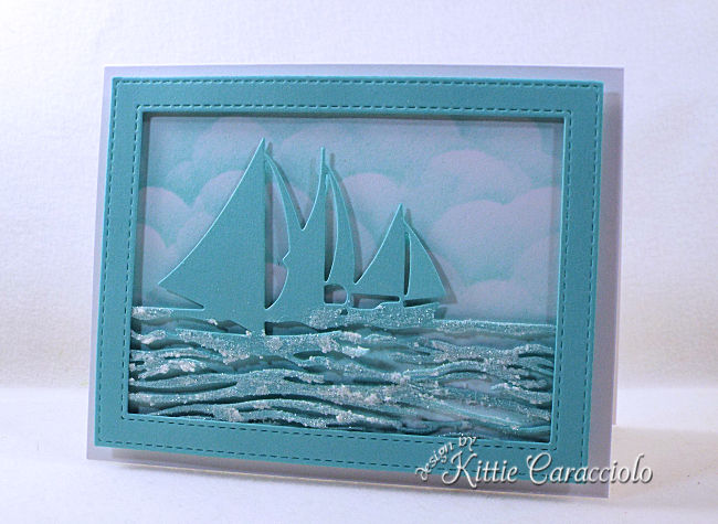 Come see how I made this monochromatic die cut sailboat frame scene perfect for lots of occasions.