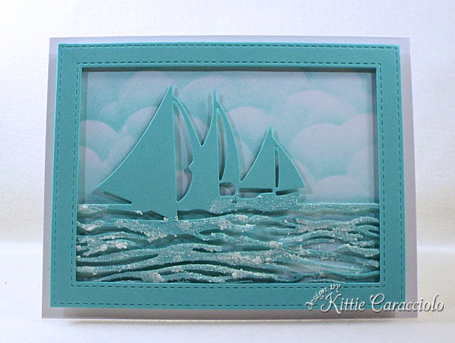 Come see how I made this monochromatic die cut sailboat frame scene.