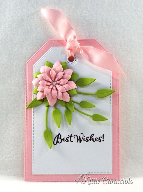 Come see how I made this pretty and feminine die cut tag and flower perfect to attach to any gift.
