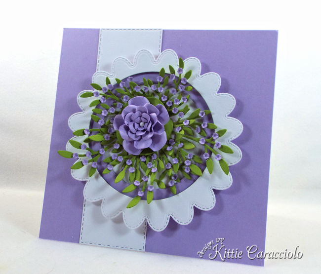 Come see how to make this die cut scalloped circle frame with flowers perfect for a flower lover.