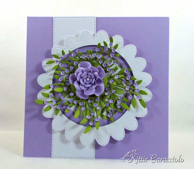 Come see how to make this die cut scalloped circle frame with flowers perfect for any occasion.
