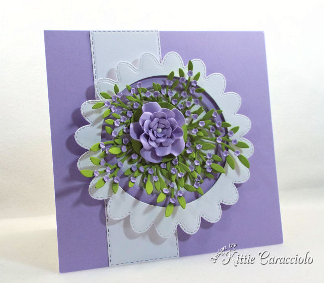 Come see how to make this die cut scalloped circle frame with flowers.
