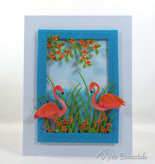 Come see out how I made this fun die cut flamingo scene card.