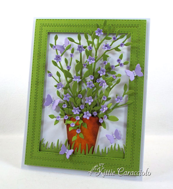 Come see this bright and pretty die cut framed potted plant and flowers that is perfect for any occasion.