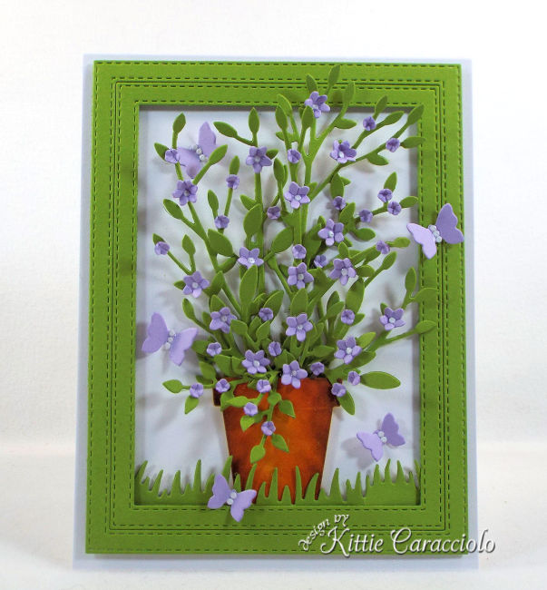 Come see this cheerful die cut framed potted plant and flowers that is perfect for any occasion