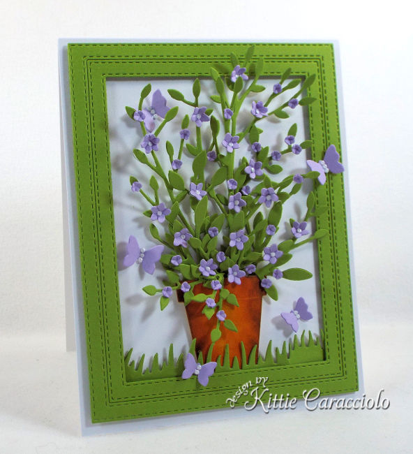 Come see this pretty die cut framed potted plant and flowers that is perfect for any occasion.