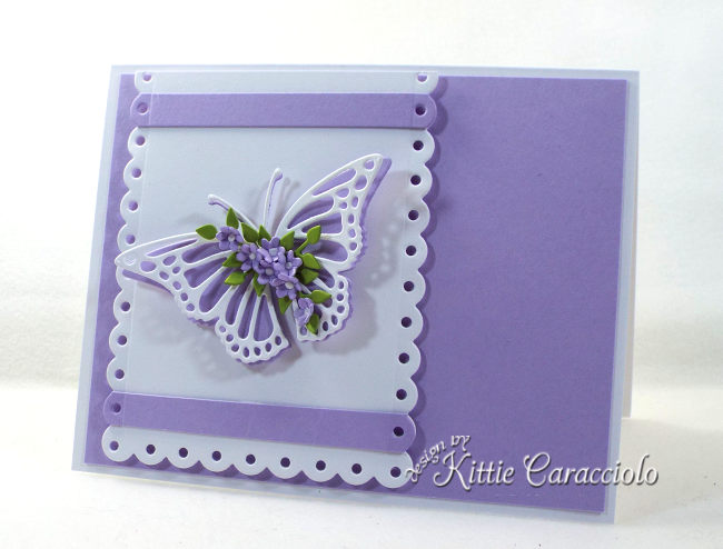 Check out how I made this elegant die cut butterfly, flowers and scallop layer card.