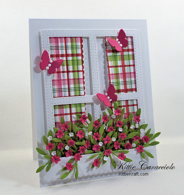 Come and see my colorful die cut window and window box full of flowers.