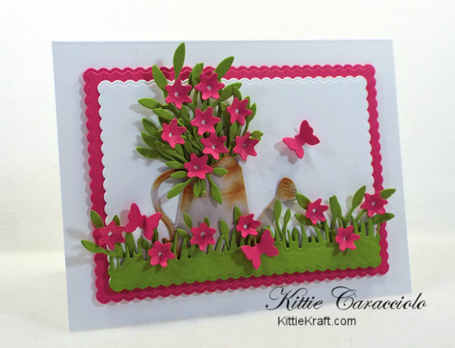 Come let me show you how I made this die cut watering can flowers scene card using Rubbernecker dies.