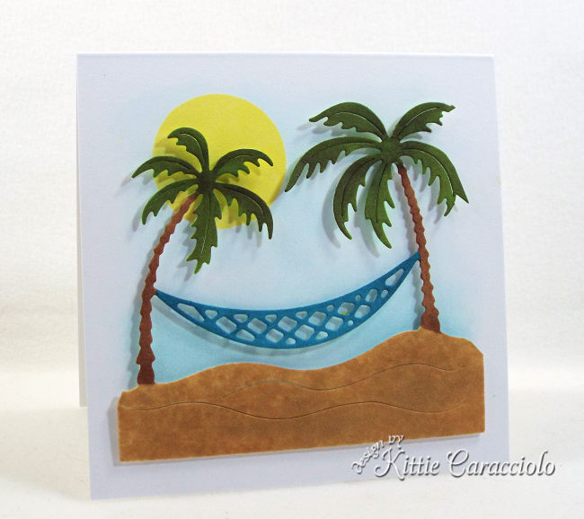 Come see how I made this clean and simple die cut tropical palm trees scene card.