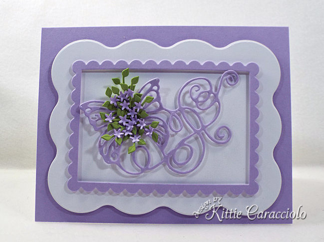 Come see how I made this die cut butterfly flourish embellished with flowers and foliage.