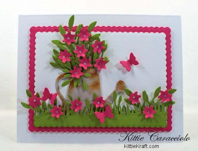 Come see how I made this die cut watering can flowers scene card using Rubbernecker dies.