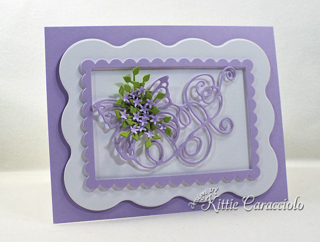Come see how I made this framed die cut butterfly flourish embellished with flowers and foliage.