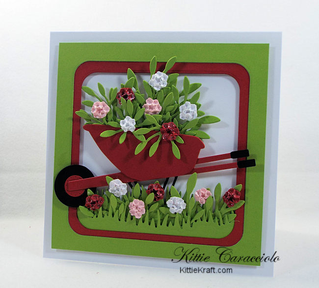 Come see how I made this bright and cheerful die cut wheelbarrow and flowers card.
