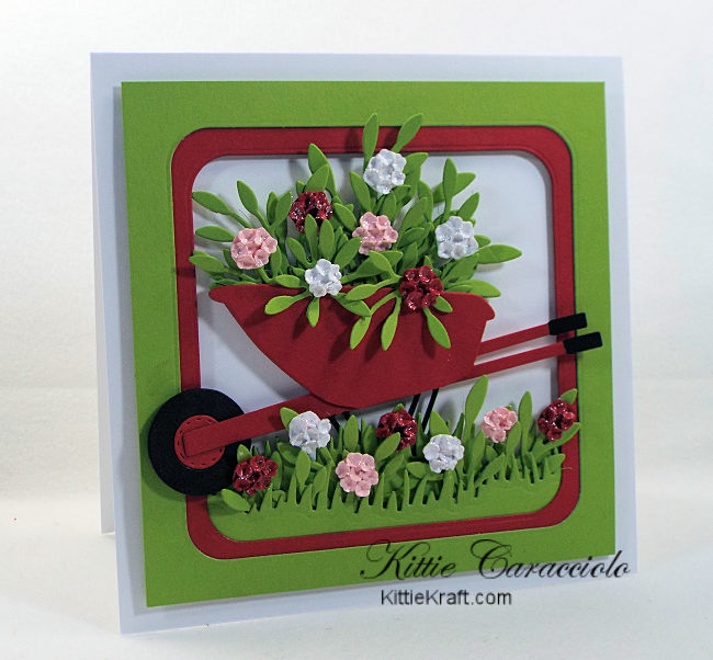 Come see how I made this bright die cut wheelbarrow and flowers card.