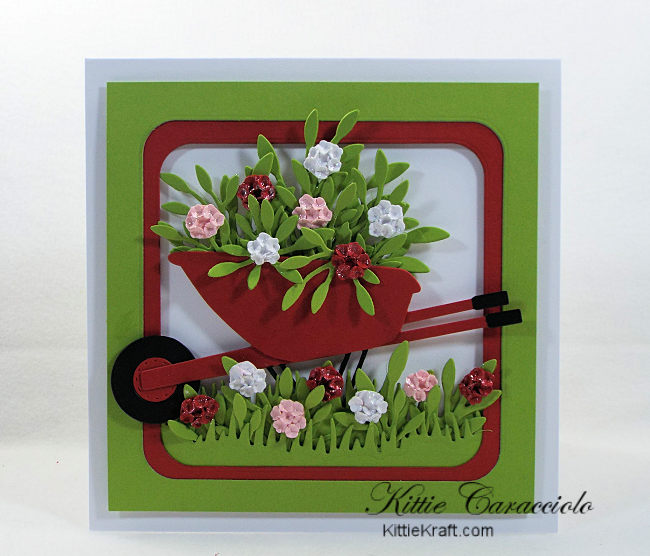 Come see how I made this cheerful die cut wheelbarrow and flowers card.