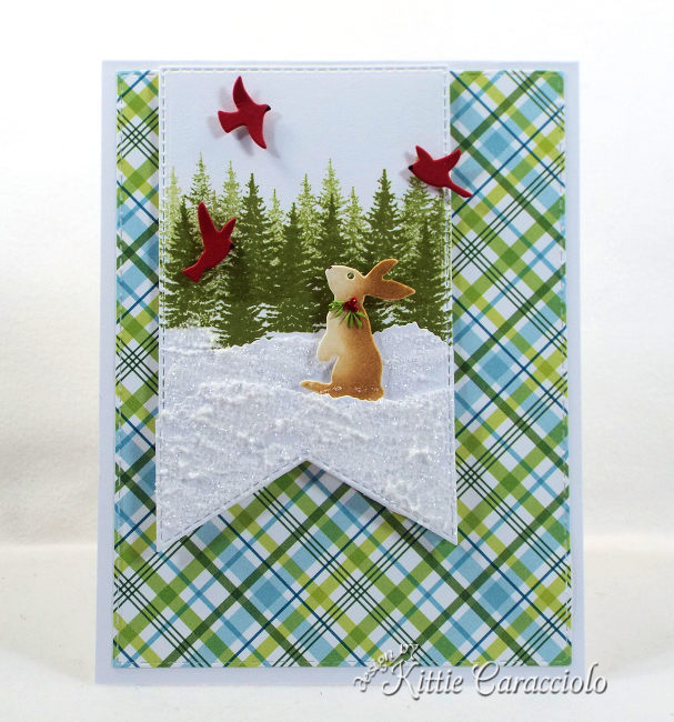 Come see how I made this fun snowy die cut bunny scene using dies made by Rubbernecker Stamps.
