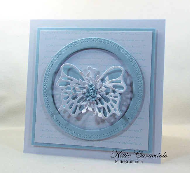 Come see how I made this pretty circle framed die cut butterfly card with a French script background and tiny flowers.