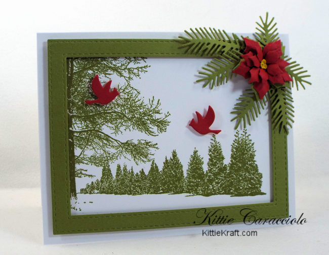 Come see how I made this simple snowy tree scene card embellished with a poinsettia and pine branches.