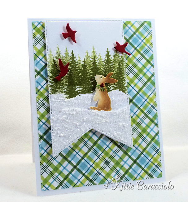 Come see how I made this sparkly snowy die cut bunny scene using dies made by Rubbernecker Stamps.