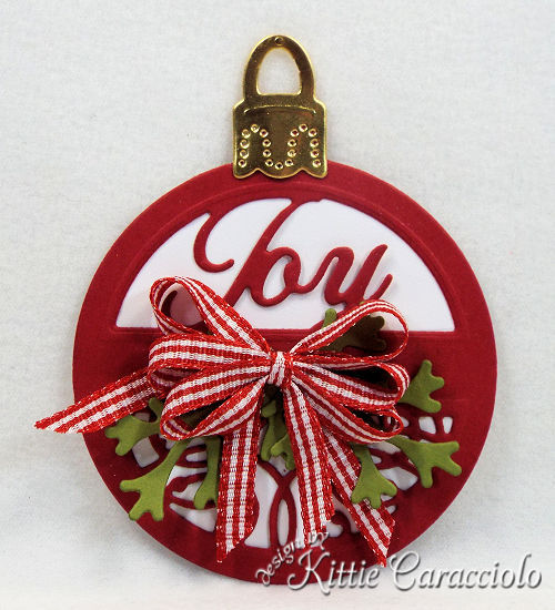 Come check out my round Joy tag made using the newly releaesed Spellbinders holiday set.