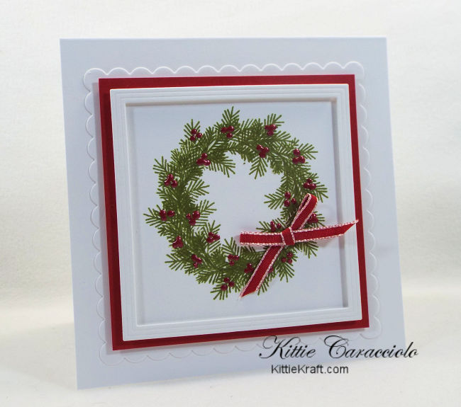 Come see how I made pretty and simple die cut and stamped wreath christmas cards.