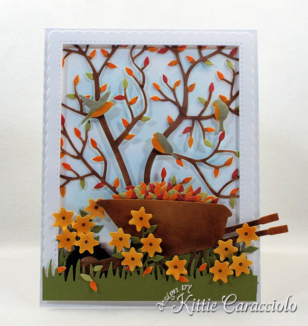 Come see how I made this colorful die cut fall leaves scene card.