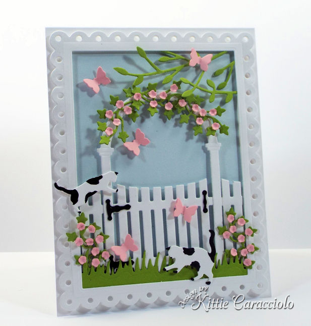Come check out how I made this pretty die cut arbor and gate scene card.
