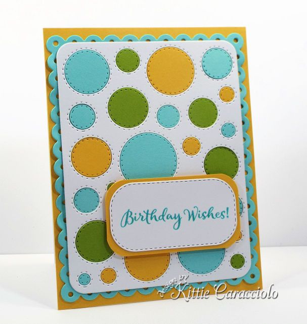 Come see how I made this cheerful circle die cut window frame card by filling in all the openings.