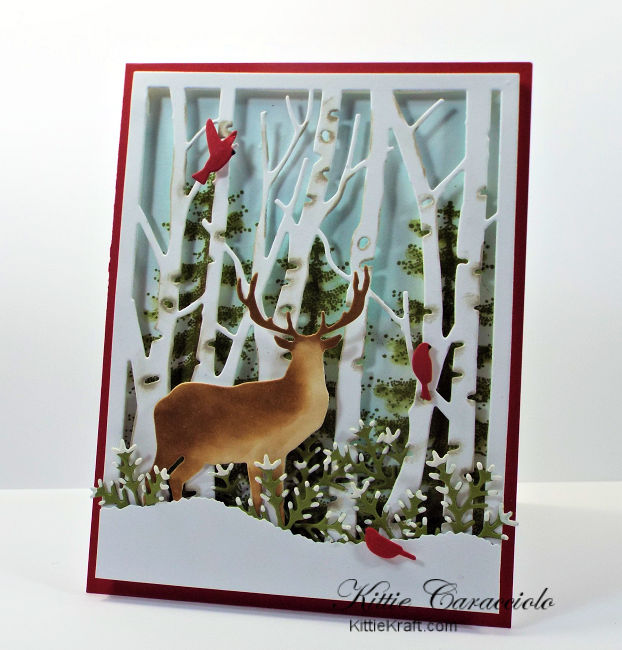 Come see how I made this die cut birch tree and deer scene card.