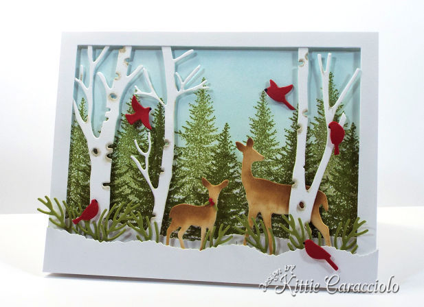 Come see how I made this die cut deer winter scene.