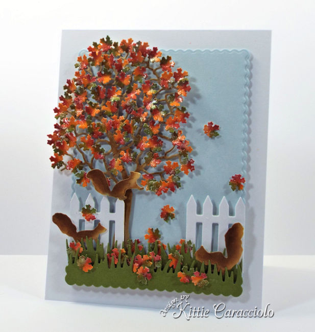 Come see how I made this die cut fall tree scene with squirrels card.