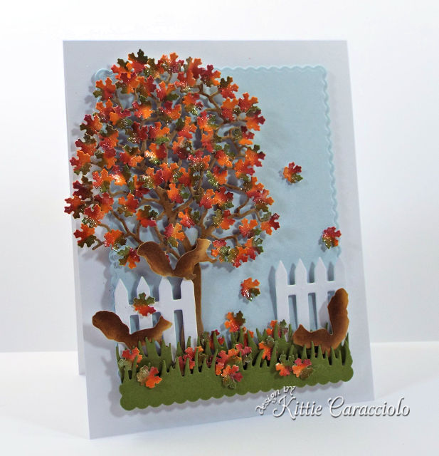 Come see how I made this lovely die cut fall tree scene with squirrels card.