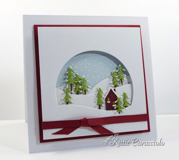 Come see how I made this pretty die cut alpine window scene.