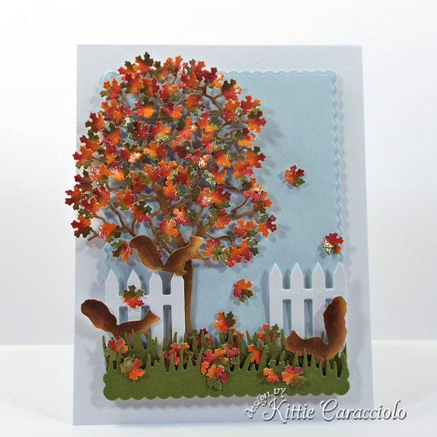 Come see how I made this pretty die cut fall tree scene with squirrels card.