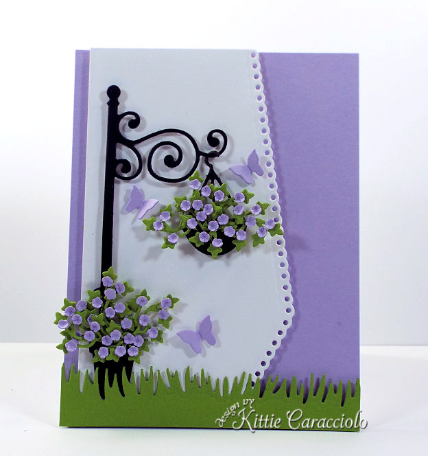 Come see how I made this pretty die cut lamp post and flowers scene.