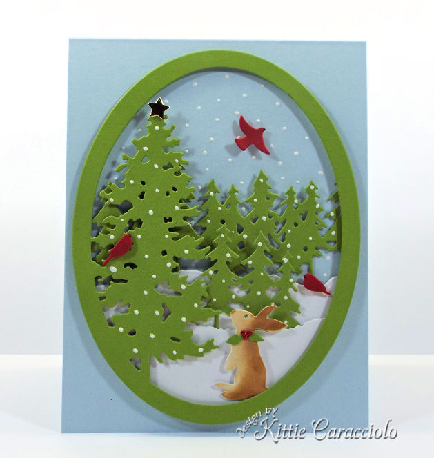 Come see how I made this pretty die cut pine tree snow scene