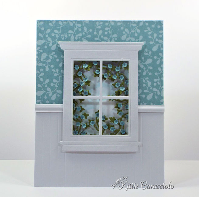 Come see how I made this elegant die cut window scene with ivy and flowers.