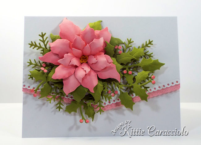 Come see how I made this pretty poinsettia Christmas card with holly and pine sprig branches.