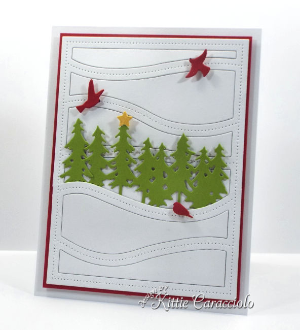 Come see how I made this simple and clean die cut Christmas scene card.