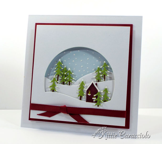 Come see how I made this snowy die cut alpine window scene.