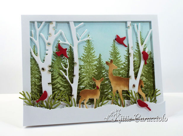 Come see how I made this snowy die cut deer winter scene.