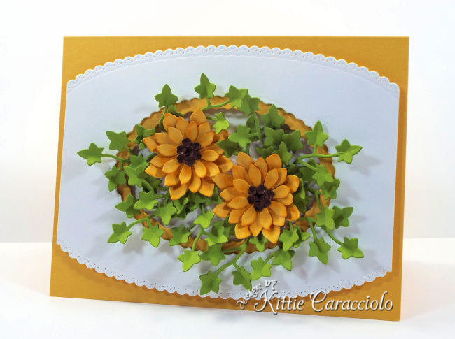 Come see my die cut fall sunflowers card arranged with a pretty white decorative frame.