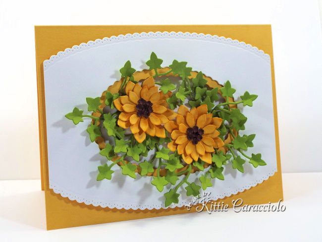 Come see my pretty die cut fall sunflowers card arranged with a pretty white decorative frame.