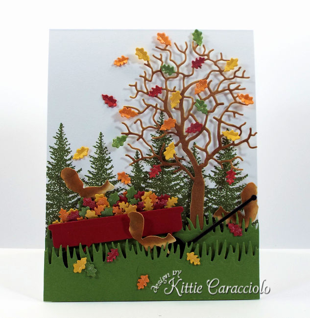 Come see how I made this colorful die cut fall tree and wagon scene.