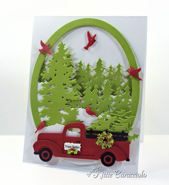 Come see how I made this die cut christmas truck and trees card.