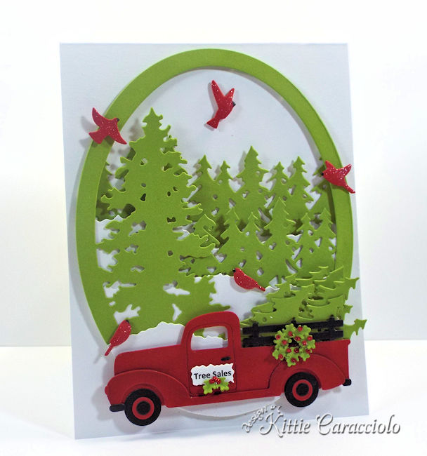 Come see how I made this die cut christmas truck and trees scene card.