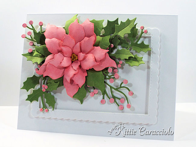 Come see how I made this die cut pink poinsettia embellished with holly and berry branches.