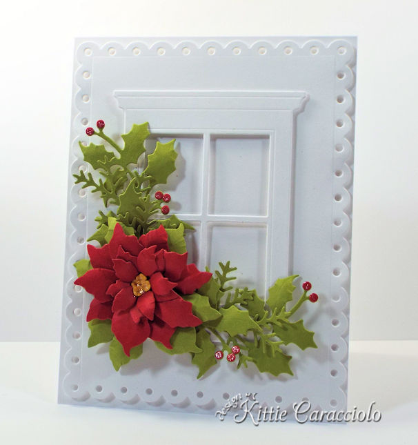 Come see how I made this die cut window and poinsettia card.