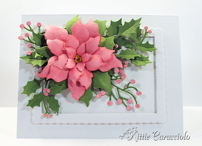 Come see how I made this elegant die cut pink poinsettia embellished with holly and berry branches.